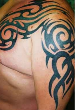 Tribal Arm Tattoos Arm Tattoo Photo of an arm and chest tribal tattoo.
